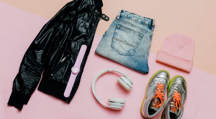 Fashion Outfit for a girl. Stylish black clothes and bright accessories. Sports Urban. Minimal. Headphones and Sneakers Active Street Life