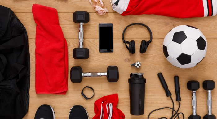 Workout, soccer and sport equipment background top view. Set of fitness male outfit. Active lifestyle, body care concept